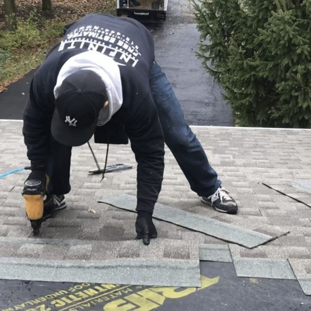 infinite roofing crewmember shingling a roof