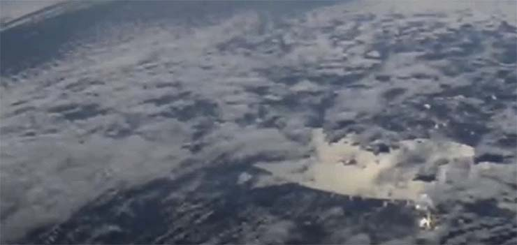 The International Space Station captures a huge alien spacecraft hidden in the clouds
