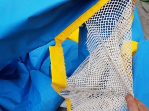 Netting needs repair on a bouncy castle