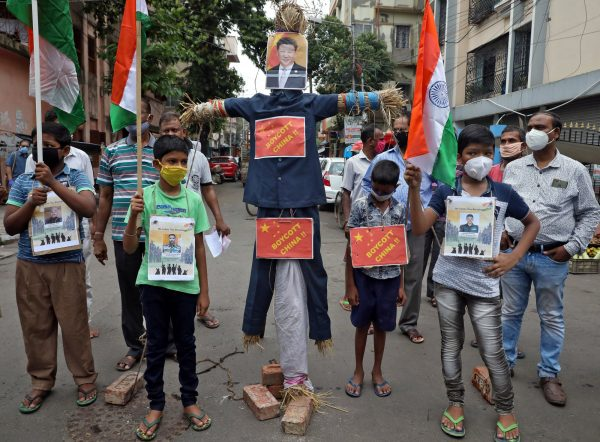 Demonstrators stand next to an effigy depicting Chinese President Xi Jinping before burning it during a protest against China, in Kolkata, India, 18 June 2020 (Photo: Reuters/Rupak De Chowdhuri).