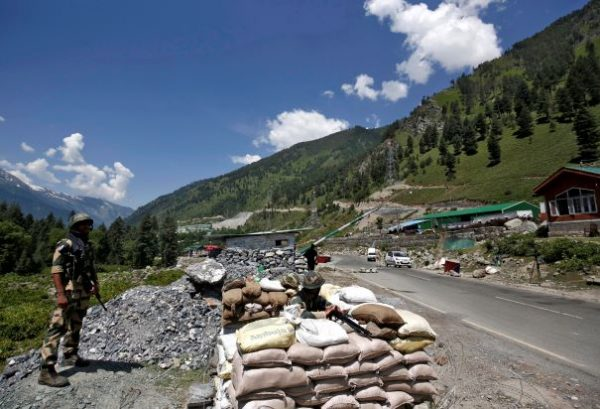 India's Border Security Force (BSF) soldiers stand guard at a checkpoint along a highway leading to Ladakh, at Gagangeer in Kashmir's Ganderbal district, India, 17 June 2020 (Photo: Reuters/Danish Ismail).