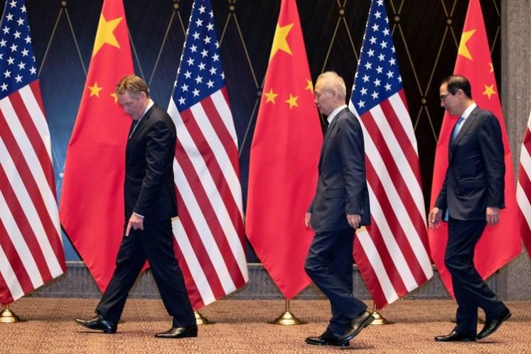 Los expertos han citado la guerra comercial entre China y EEUU como una de las posibles fuentes de la desaceleración global (Foto: Ng Han Guan/Reuters)
