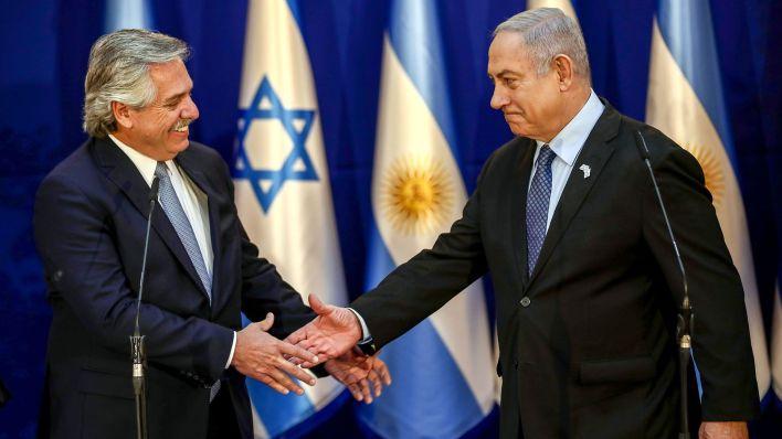Presidente Fernández y Premier Netanyahu. (POOL / AFP)