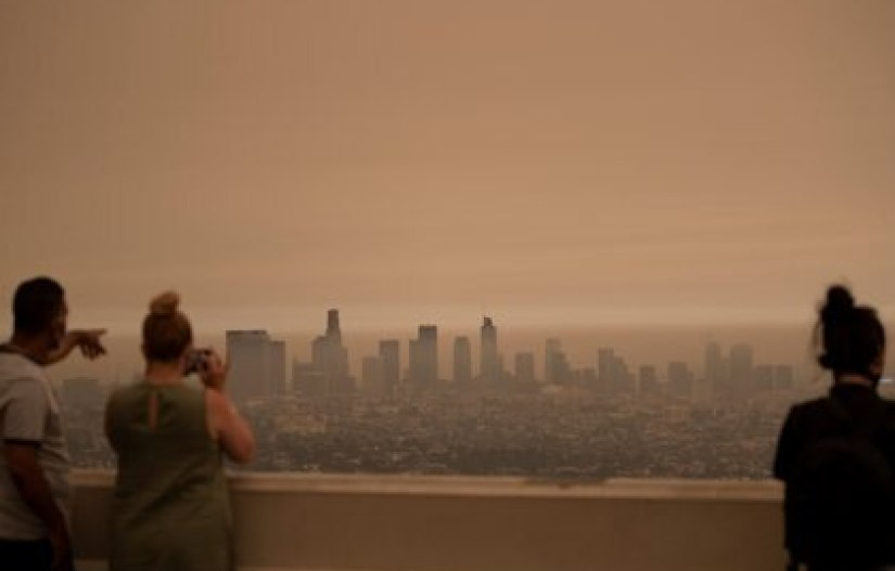 Smoke covers the Los Angeles sky (Reuters)