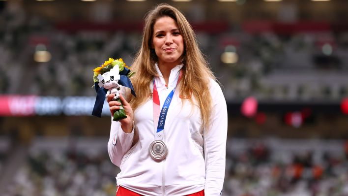 Tokyo 2020 Olympics - Athletics - Women's Javelin Throw - Medal Ceremony - Olympic Stadium, Tokyo, Japan - August 7, 2021. Silver medallist, Maria Andrejczyk of Poland reacts on the podium REUTERS/Andrew Boyers