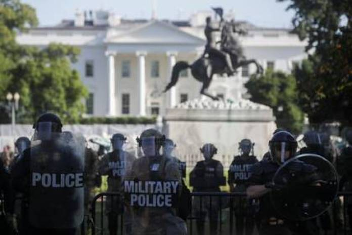 National Guard guards the White House in front of protesters (Reuters)