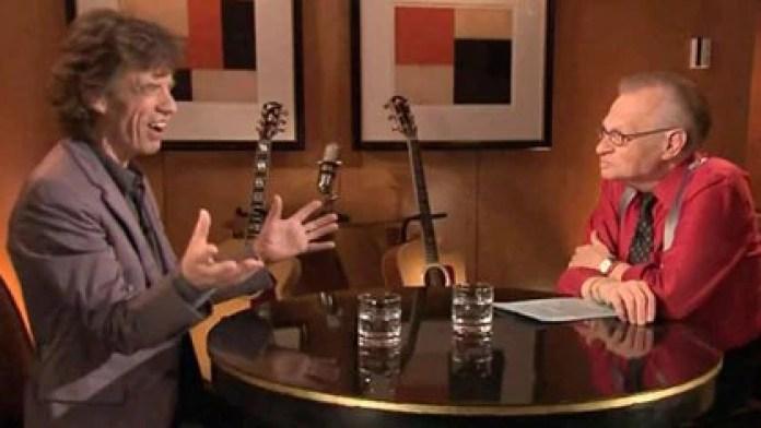 Larry King junto a Mick Jagger