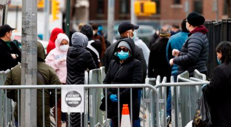 Several people wait to enter a medical check-up and get a coronavirus test, on April 14, 2020, at the Elmhurst Hospital Center in Queens, in New York (USA).  EFE / Justin Lane / Archive