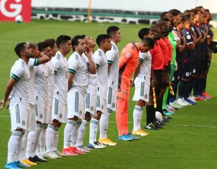 Soccer Football - Concacaf Olympic Qualifiers - Mexico v Dominican Republic - Estadio Jalisco, Guadalajara, Mexico - March 18, 2021 Players and referees lineup before the match REUTERS/Henry Romero