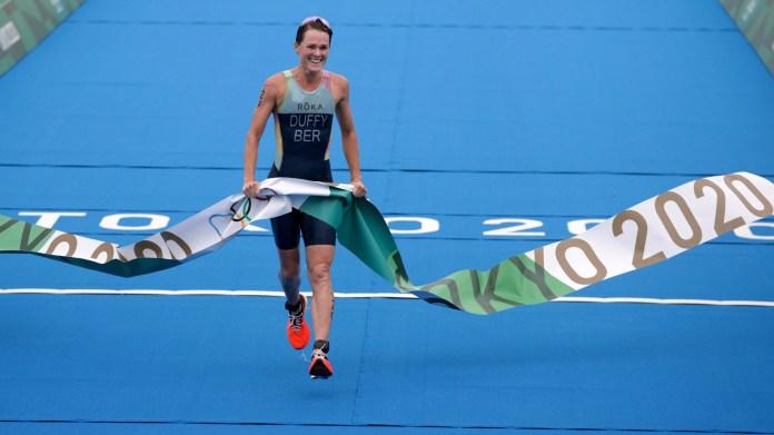 The winner of the women's triathlon celebrates in the Japanese capital.  Photo: REUTERS / Hannah Mckay
