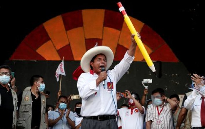 FILE PHOTO: Peru's presidential candidate Pedro Castillo of Peru Libre party, who will compete head-to-head with right-wing candidate Keiko Fujimori in a second-round ballot in June, speaks to supporters during a rally in Lima, Peru/File Photo