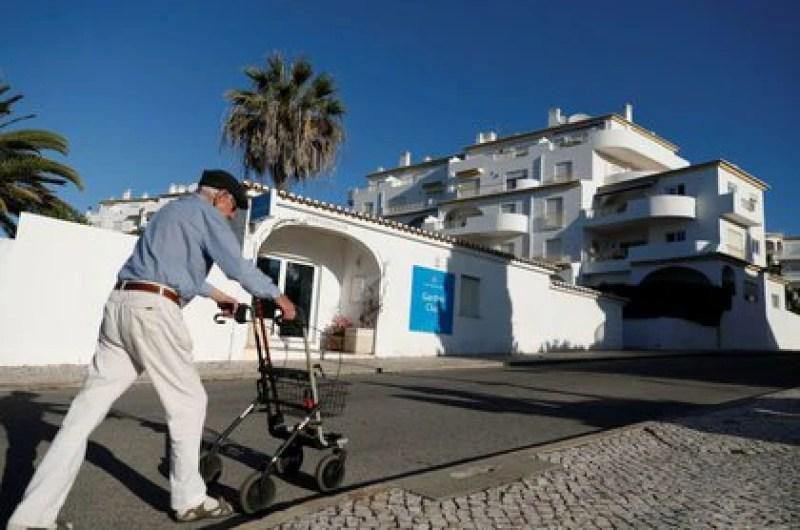 A man walks past the apartment where three-year-old Madeleine McCann disappeared in 2007, in Praia da Luz, Portugal (Reuters)