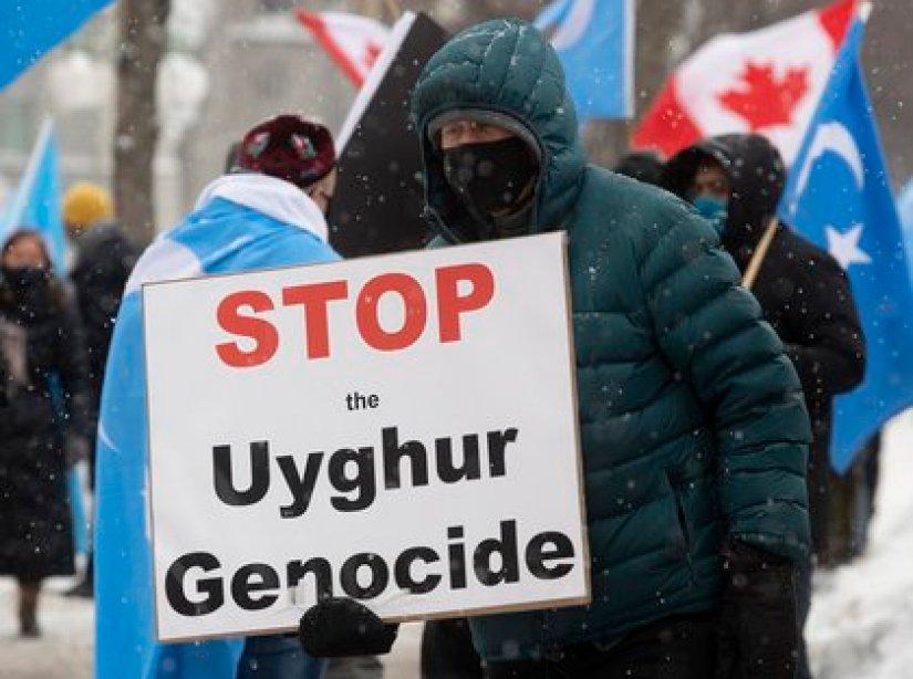 """""""Stop the Uyghur Genocide"""" (AP)"""