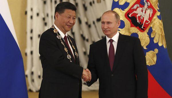 Vladimir Putin y su par chino, Xi Jinping