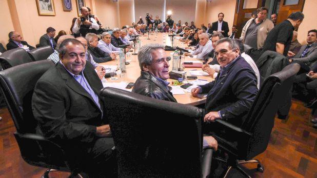 La cúpula de la CGT: Hector Daer, Carlos Acuña y Juan Carlos Schmid