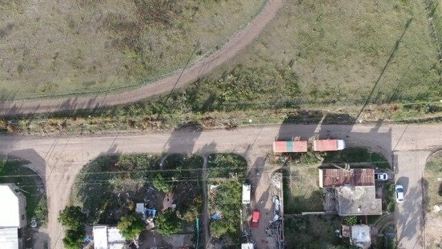 Las casas del barrio Villa Alicia están muy cerca de los campos fumigados