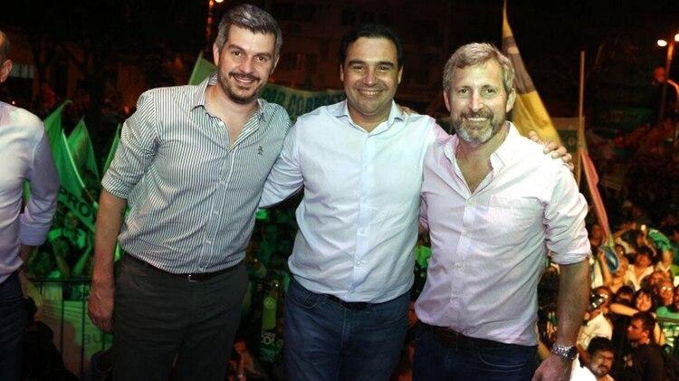 Marcos Peña y Rogelio Frigerio junto a Valdes