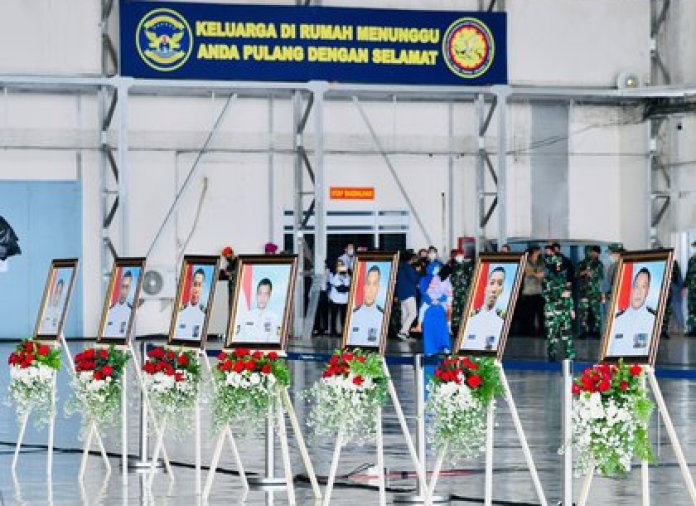 Portraits of crew members from the sunk submarine KRI Nanggala-402 during a visit by Indonesian President Joko Widodo to a navy airbase in Sidoarjo, East Java province, Indonesia, on April 29, 2021. Laily Rachev / Courtesy of the Presidential Palace from Indonesia / Brochure via REUTERS