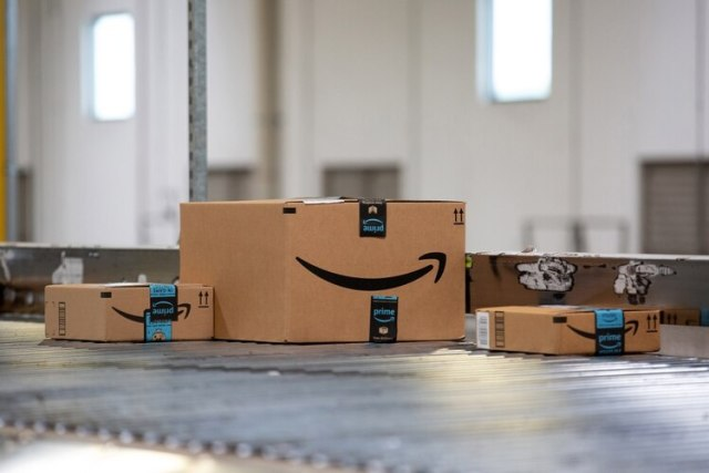 Packages move along a conveyor belt at the Amazon.com Inc. fulfillment center in Robbinsville, New Jersey on June 7. MUST CREDIT: Bloomberg photo by Bess Adler.