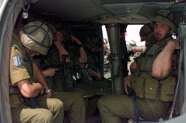 norwegian_mech_battallion_soldiers_strapping_into_uh-60
