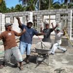 A construction team builds an elementary school on Aur Atoll.
