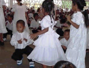 A group of children dancing at a church in Uliga. Photo: Giff Johnson