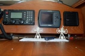 ICOM HF radio, Garmin map GPS, and radio speaker.