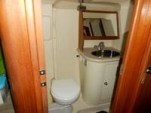 The aft head has a toilet and vanity unit next to the enclosed shower.