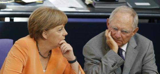 german-chancellor-merkel-speaks-with-finance-minister-schaeuble-during-a-parliamentary-debate-on-the-greek-debt-crisis-at-the-german-lower-house-of-parliament-bundestag-in-berlin