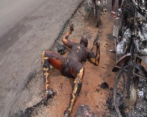 GOOGLE IMAGE: CHARRED REMAINS OF A MAN & HIS MOTORCYCLE