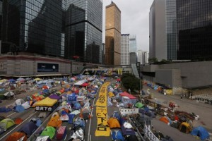 Huge protest banners block a main road along with tents set up by pro-democracy protesters outside the government headquarters at Admiralty in Hong Kong