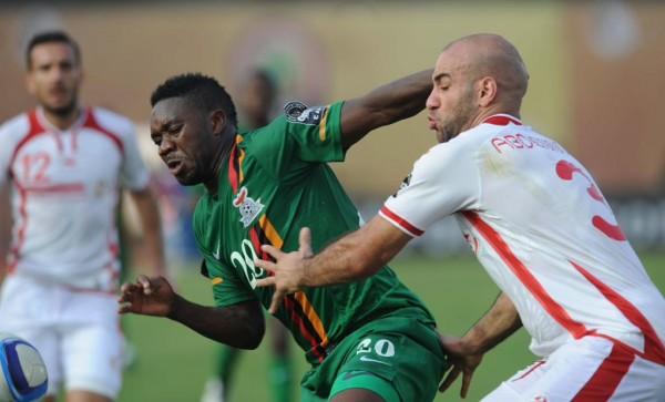 Emmanuel Mayuka of Zambia battles with Aymen Abdennour of Tunisia . Image: Caf via Getty.