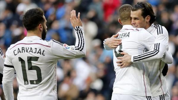 Karim Benzema Celebrates His Brace With Gareth Bale and Dani Carvajal. Image: Getty Europe.