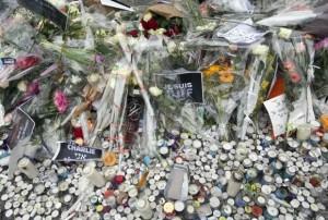 Flowers are placed at the Hyper Cacher kosher supermarket near Porte de Vincennes in eastern Paris