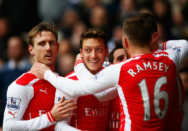 Arsenal Celebrate Mesut Ozil's Goal at White hart Lane. Image: Getty.