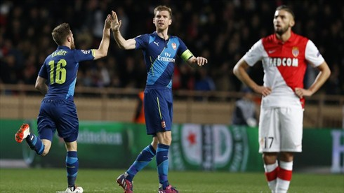 Per Mertesacker and Aaron Ramsey after the Welshman's Goal at Monaco. Image: AFP/Getty.