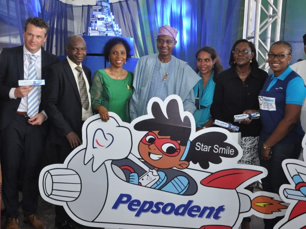Dr. Khaliru Alhassan, Honourable Minister of Health (Middle); Ms. Myriam Sidibe, Director for Social Missions Africa, Unilever (3rd right); Dr. Olufunmilayo Ashiwaju, Vice President, Nigerian Dental Association (2nd R); Nsima Alakwe, Brand Build Director, Unilever Nigeria (R); Robbert deVreede, Vice President Marketing, Unilever Nigeria ( L); Dr. Bode Ijarogbe, President, Nigerian Dental Association (2nd L); and Dr. Bimpe Adebiyi, Director/Head of Dentistry, Federal Ministry of Health at the World Oral Health Day Celebration  organised by Pepsodent and the Nigerian Dental Association in Lagos, Friday