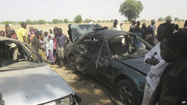 A suicide bomber blows himself up in a car at the business college