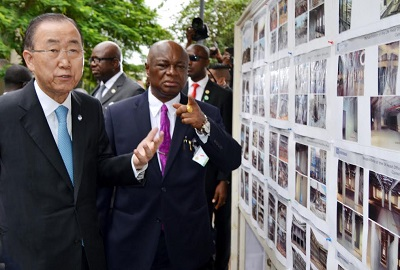 THE SECRETARY-GENERAL OF UNITED NATIONS (UN), MR BAN KIMOON (L) AND PERMANENT SECRETARY, FCT, MR JOHN CHUKWU, INSPECTING A PHOTO MONTAGE, BEING RECORD OF UNITED NATIONS BUILDING BOMBED THROUGH A CAR EXPLOSION IN AUGUST 2011, AT THE SITE IN ABUJA ON TUESDAY (24/8/15)