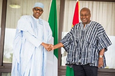 PRESIDENT MUHAMMADU BUHARI (L)  BEING BEING WELCOMED BY PRESIDENT JOHN MAHAMA OF GHANA DURING PRESIDENT BUHARI'S ARRIVAL FOR A ONE-DAY OFFICIAL VISIT AT THE KOTOKA INTERNATIONAL AIRPORT ACCRA, GHANA ON MONDAY (7/9/2015) 6472/7/9/2015/ICE/NAN