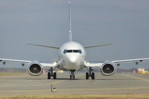 White jet passenger or cargo plane on runway