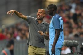 Yaya Toure and Pep Guardiola