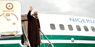 President Buhari waving from aircraft door