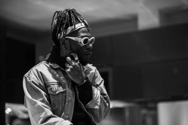 burnaboi - [Video]: Watch how Burna Boy Kicked A Fan Who Tried Stealing From Him While Performing