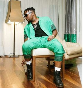 """touching throwback photos of olamide dj enimoney late parents - Did Olamide Just Reveal Inspiration Behind His Single """"Poverty Die"""""""