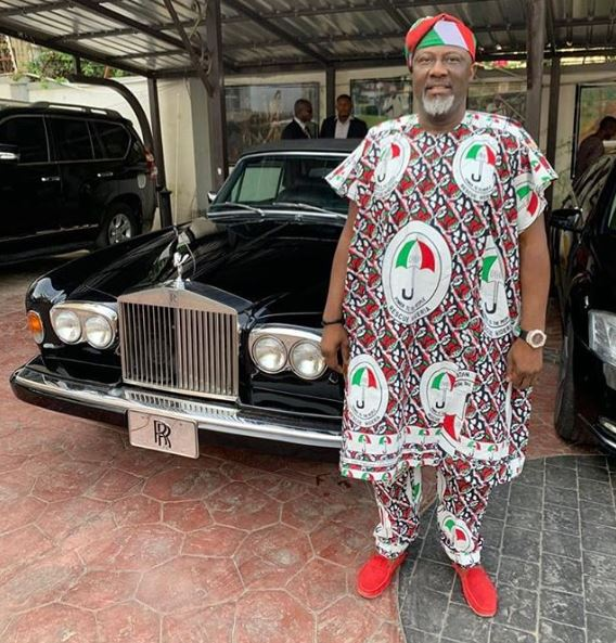 dino melaye wears pdp agbada as he poses with his fleet of cars photo - [Video]: Lawmaker Expresses Shock After Visiting Melaye's Garage