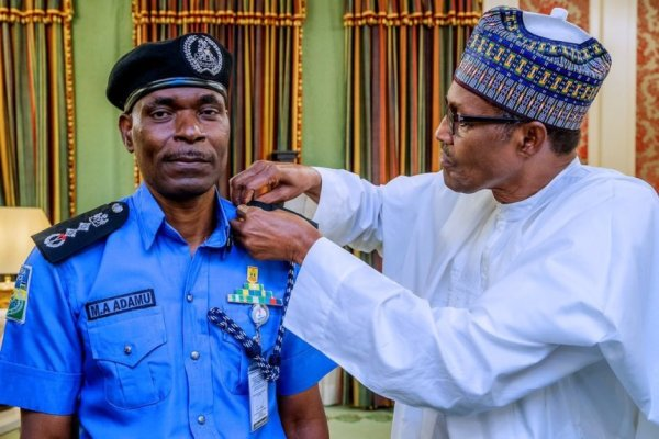 Acting IGP Mohammed Adamu with President Muhammadu Buhari 5 - 3 Nigerian police officers sacked for receiving $5000 bribe