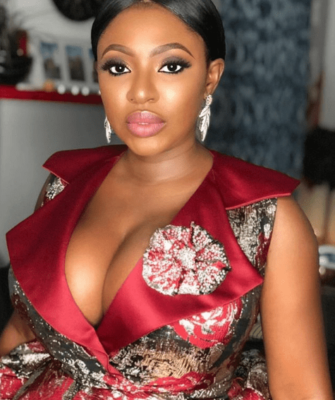Capture 9 - Nollywood actress Yvonne Jegede flaunts her huge boobs in dangerously plunging dress