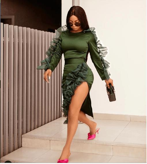 [Photos]: Toke Makinwa flaunts major skin in thigh-high slit dress