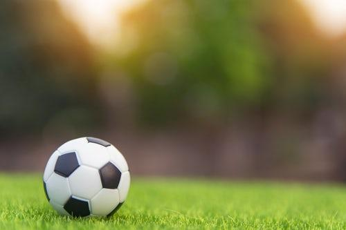 A soccer ball on the pitch